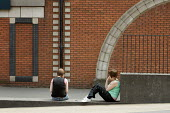 Bored teenagers sit on a wall in Walsall town centre, West Midlands - Philip Wolmuth - 30-06-2008