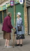 Two elderly women with walking sticks chat in Paddington, London. - Philip Wolmuth - 2000s,2008,age,ageing population,bought,buy,buyer,buyers,buying,closed,closing,closure,closures,commodities,commodity,communities,community,consumer,consumers,customer,customers,discuss discussing,EBF
