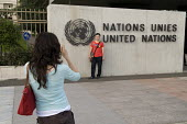 Tourists take photographs outside the Palais des Nations, United Nations European Headquarters building in Geneva Switzerland - Philip Wolmuth - 2000s,2008,BME minority ethnic,building,BUILDINGS,camera,cameras,chinese,digital,EBF Economy,eu,european,europeans,Extraterritoriality,FEMALE,Headquarters,holiday,holiday maker,holiday makers,holidaym