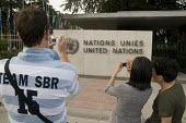 Tourists take photographs outside the Palais des Nations, United Nations European Headquarters building in Geneva Switzerland - Philip Wolmuth - 25-07-2008