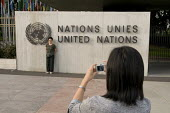 Tourists taking photographs outside the Palais des Nations, United Nations European Headquarters building, Geneva, Switzerland - Philip Wolmuth - 25-07-2008
