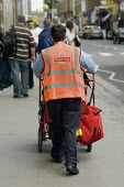 Postman on a delivery round in Paddington. London - Philip Wolmuth - 10-09-2008