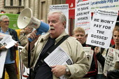 Bill Mullins, of the National Shop Stewards Network, speaks at a demonstration outside the Bank of Englandagainst the bank bail out. - Philip Wolmuth - 2000s,2008,activist,activists,against,anti,bail-out,bank,banking,banks,CAMPAIGN,campaigner,campaigners,CAMPAIGNING,CAMPAIGNS,capitalism,capitalist,cities,City,Credit Crunch,DEMONSTRATING,demonstration