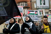 Demonstration outside the Israeli Embassy in South Kensington, London, called by the Palestine Solidarity Campaign, Stop the War Coalition, British Muslim Initiative and other organisations, to protes... - Philip Wolmuth - 2000s,2008,activist,activists,CAMPAIGN,campaigner,campaigners,CAMPAIGNING,CAMPAIGNS,Coalition,DEMONSTRATING,demonstration,DEMONSTRATIONS,dress,FEMALE,Gaza,hajib,headscarf,hijab,Islam,Islamic,Israeli,K