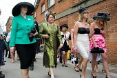 Racegoers approach the Royal Enclosure at Ascot racecourse on Ladies Day. - Philip Wolmuth - &,2000s,2009,AFFLUENCE,AFFLUENT,Bourgeoisie,class,day out,Day Tripper,Day Trippers,dressed up,dressing up,elite,elitism,EQUALITY,fashion,fashionable,fashions,FEMALE,hat,hats,high,high income,income,IN