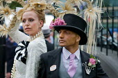 Louis Mariette, bespoke couture hat designer, outside the Royal Enclosure at Ascot racecourse on Ladies Day. - Philip Wolmuth - &,2000s,2009,ACE,AFFLUENCE,AFFLUENT,asian,asians,BAME,BAMEs,Black,BME,bmes,Bourgeoisie,celebrity,class,culture,day out,Day Tripper,Day Trippers,designer,DESIGNERS,diversity,dressed up,dressing up,elit