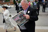 Irish horse owner John Duddy reading the Racing Post outside the Royal Enclosure at Ascot racecourse. - Philip Wolmuth - &,2000s,2009,AFFLUENCE,AFFLUENT,age,ageing population,Bourgeoisie,day out,Day Tripper,Day Trippers,domesticated ungulates,dressed up,dressing up,elderly,elite,elitism,EQUALITY,equestrian,equine,high,h