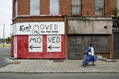 Ken's Moved. Houses and shops in Granby Street, Liverpool 8, scheduled for demolition by the Merseyside NewHeartlands partnership, financed by the Housing Market Renewal Fund, part of a government str... - Philip Wolmuth - 2000s,2009,BME black,boarded up,brownfield site,closed closure,derelict,DERELICTION,developer,developers,DEVELOPMENT,development redevelopment,EBF Economy,empty properties,England,EQUALITY,ethnic,ETHN