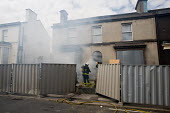 Firefighters use an empty house in Anfield, close to Liverpool football stadium, in a training exercise. - Philip Wolmuth - 19-06-2009
