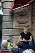 A waitress takes a lunch order at an Italian cafe in central London. - Philip Wolmuth - 2000s,2009,cafe,cafes,catering,cities,city,EARNINGS,EBF,Economic,Economy,employee,employees,employment,EQUALITY,FEMALE,Hospitality,Income,INCOMES,inequality,Italian,job,jobs,LAB,LAB LBR Work,LBR,livin