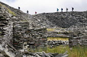 Walkers pass an abandoned slate quarry, Snowdonia National Park, Wales - Philip Wolmuth - 2000s,2009,abandoned,ACE,Archaeology,building,BUILDINGS,closed,closing,closure,closures,country,countryside,culture,derelict,DERELICTION,EBF,Economic,Economy,ENI,environment,environmental issues,exerc