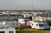 A caravan park next to the Little Cheyne Court Wind Farm (Npower Renewables Wind Farm). - Philip Wolmuth - ,(RV,2000s,2009,alternative energy,and,bird,birds,boy,boys,capitalism,capitalist,caravan,caravans,child,CHILDHOOD,children,coast,coastal,coasts,companies,company,country,countryside,Court,DAD,DADDIES,