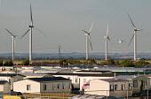 A caravan park next to the Little Cheyne Court Wind Farm (Npower Renewables Wind Farm). - Philip Wolmuth - 23-08-2009