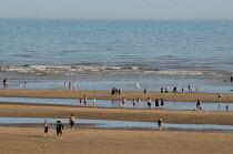 Tourists on the beach at Camber Sands, in Kent. - Philip Wolmuth - 2000s,2009,beach,beaches,boy,boys,child,CHILDHOOD,children,coast,coastal,coastline,coastlines,coasts,female,females,girl,girls,holiday,holiday maker,holiday makers,holidaymaker,holidaymakers,holidays,