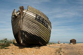Decaying fishing boats and fishermens huts on the shingle beach at Dungeness. - Philip Wolmuth - 23-08-2009