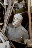 Damaged statue of Stalin from the former Soviet Union (USSR) abandoned in the basement of the Museum of Modern History, Veliko Tarnovo. - Philip Wolmuth - 2000s,2009,abandoned,ACE,ace culture,art,arts,artwork,artworks,basement,basements,Bulgaria,bulgarian,bulgarians,Cold War,communism,Communist Party,communists,culture,damage,damaged,damages,debris,deca