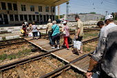 Passengers disembark from a train at a small rural station in central Bulgaria. - Philip Wolmuth - 2000s,2009,bag,bags,bought,Bulgaria,bulgarian,bulgarians,buy,buyer,buyers,buying,commodities,commodity,consumer,consumers,customer,customers,Eastern Europe,EBF,EBF Economy,Economic,Economy,EQUALITY,eu