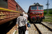 Passengers disembark from a train at a small rural station in central Bulgaria. - Philip Wolmuth - ,2000s,2009,bought,Bulgaria,bulgarian,bulgarians,buy,buyer,buyers,buying,carriage,carriages,commodities,commodity,consumer,consumers,country,countryside,customer,customers,Eastern Europe,EBF,EBF Econo