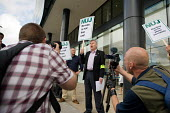 NUJ Freelance Organiser John Toner supports an NUJ protest outside the offices of; Guardian News & Media against the company's plans to stop paying freelance photographers for reuse of their pictures. - Philip Wolmuth - 01-09-2009