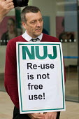 NUJ General Secretary Jeremy Dear supports an NUJ protest outside the offices of Guardian News & Media against the company's plans to stop paying freelance photographers for reuse of their pictures. - Philip Wolmuth - 01-09-2009