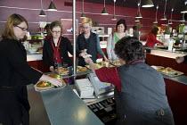 Catering worker in a canteen in a municipal building in Helsinki run by Palmia, a municipal enterprise. - Philip Wolmuth - 2000s,2009,BREAK,buffet,building,BUILDINGS,cafetería,cafeteria,canteen,canteens,casher,cashers,caterer,caterers,catering,checkout,counters,Customer,Customers,DINNER,dinners,DINNERTIME,EARNINGS,EBF,Ec