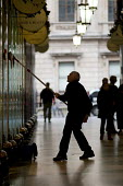 A man cleans the windows of exclusive shops in the Piccadilly Arcade, Mayfair, London. - Philip Wolmuth - 27-10-2009