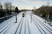 Intercity train following a snowfall, Cricklewood, London. - Philip Wolmuth - 2010,2010s,cities,city,CLIMATE,cold,conditions,EBF,Economic,Economy,frozen,journey,journeys,locomotive,LOCOMOTIVES,network,precipitation,public,public service,RAIL,railway,railway engine,railways,seas