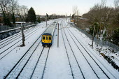 First Capital Connect train on the Thameslink line following a snowfall, Cricklewood, London. - Philip Wolmuth - 2010,2010s,Capital,cities,city,CLIMATE,cold,conditions,EBF,Economic,Economy,frozen,journey,journeys,locomotive,LOCOMOTIVES,network,precipitation,public,public service,RAIL,railway,railway engine,railw