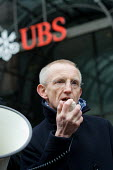A UNITE speaker at a rally in support of Alberto Durango, a member of UNITE and the Latin American Workers Association, outside the London headquarters of Swiss bank UBS, where he worked as a cleaner... - Philip Wolmuth - 2010,2010s,activist,activists,American,americans,bank,banks,CAMPAIGNING,CAMPAIGNS,capitalism,cleaner,cleaners,cleaning,cleansing,contractor,contractors,DEMONSTRATING,demonstration,EARNINGS,headquarter