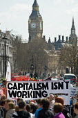 Capitalism isn't working banner showing a queue of the unemployed after the Conservative poster Labour isn't working. Protect our Welfare State and Public Services march london - Philip Wolmuth - 10-04-2010