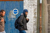 Following an early morning police raid, migrants are evicted from a squat in a disused warehouse in Calais known as the Africa House, used as a shelter by up to 100 people seeking to cross the Channel... - Philip Wolmuth - 2010,2010s,adult,adults,Africa,asylum,Asylum Seeker,Asylum Seeker,asylum-seekers,BME black,destitute,Diaspora,displaced,disused,ethnic,ETHNICITY,eu,Europe,european,europeans,europeregi,eurozone,foreig