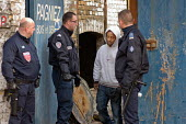 French CRS riot police raid a squat in a disused warehouse in Calais known as the Africa House, used as a shelter by up to 100 African migrants seeking to cross the Channel to the UK. - Philip Wolmuth - 2010,2010s,adult,adults,Africa,African,arrest,arrested,arresting,asylum,Asylum Seeker,Asylum Seeker,asylum-seekers,BME black,CLJ,destitute,detention detained,Diaspora,displaced,disused,enforcement,eth