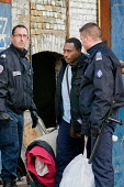 Following an early morning police raid, migrants are evicted from a squat in a disused warehouse in Calais known as the Africa House, used as a shelter by up to 100 people seeking to cross the Channel... - Philip Wolmuth - 2010,2010s,adult,adults,Africa,arrest,arrested,arresting,asylum,Asylum Seeker,Asylum Seeker,asylum-seekers,BME black,CLJ,destitute,detention detained,Diaspora,displaced,disused,enforcement,ethnic,ETHN