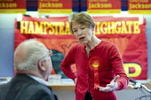 Labour MP Glenda Jackson talks with constituents and party supporters in her local campaign office during the 2010 General Election campaign in the newly created marginal constituency of Hampstead and... - Philip Wolmuth - ,2010,2010s,age,ageing population,campaign,campaigning,CAMPAIGNS,communicating,communication,conversation,conversations,democracy,dialogue,discourse,discuss,discusses,discussing,discussion,elderly,ELE