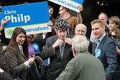 London Mayor Boris Johnson campaigns on behalf of Conservative parliamentary candidate Chris Philp in the marginal constituency of Hampstead and Kilburn. - Philip Wolmuth - 2010,2010s,CAMPAIGN,campaigning,CAMPAIGNS,candidate,CANDIDATES,CANVASING,canvassing,Conservative,Conservative Party,conservatives,democracy,ELECTION,electioneering,elections,General Election,London,Ma