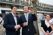 Conservative MP Nick Hurd talks with Neighbourhood Manager Marco Torquati during a visit t0 projects in Church Street, London, supported by the Paddington Development Trust. - Philip Wolmuth - 20-05-2010