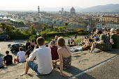 Young people on a terrace overlooking the River Arno and the landmark Duomo, Florence, Italy. - Philip Wolmuth - 05-06-2010