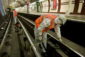 Deep Cleaning Gang employed by a sub-contractor Initial Transport Services working through the night at Edgware Road tube station on the Bakerloo Line. The track in the station and 50 metres into each... - Philip Wolmuth - 28-05-2010
