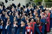 University of East Anglia (UEA) students pose for their graduation photograph. Throwing their hats in the air. - Philip Wolmuth - 2010,2010s,academic,ACADEMICS,achievement,alumni,Anglia,boards,ceremonies,ceremony,degree,degrees,East,edu,EDU education,educate,educating,education,educational,eduction,FEMALE,gown,gowns,graduate,gra
