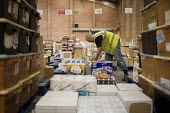 An ex-claimant of Job Seekers Allowance working in a warehouse on Stakehill Industrial Estate, Oldham, following a compulsory four week unpaid work placement, part of a Mandatory Work Related Activity... - Philip Wolmuth - 07-10-2010