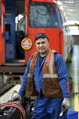 Worker at London Underground Northumberland Park Depot which services the 42 tube trains on the Victoria line - Philip Wolmuth - 03-12-2009