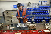 London Underground's Northumberland Park Depot, which services the 42 tube trains on the Victoria line. Reparing and servicing on a workbench. - Philip Wolmuth - 03-12-2009