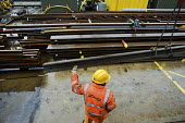 A worker in the Points and Crossings Shed of London Underground's Lillie Road Depot. The depot produces replacement track for the tube network and offers a same day service for urgent repairs and repl... - Philip Wolmuth - ,2010,2010s,administration,banksman,capitalism,capitalist,cities,city,contractor,contractors,crane,cranes,EBF,Economic,Economy,employee,employees,employment,engineer,engineering,Engineering Industry,e