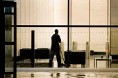 Cleaner on a night shift in offices in the City of London. - Philip Wolmuth - 2010,2010s,BAME,BAMEs,Black,BME,bmes,by hand,capitalism,capitalist,casual workers,cities,City,cleaner,cleaners,cleaning,cleansing,CONTRACTOR,contractors,Diaspora,diversity,EARNINGS,employee,employees,