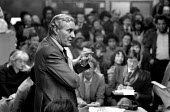 1982: Tony Benn speaks at a packed public meeting in the 510 Community Centre, called to oppose the closure of St. Mary's Hospital, Harrow Road. West London. - Philip Wolmuth - 24-02-1982