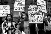 Residents of Mozart Estate, West London, protest at Marylebone Magistrates Court at the arrest of 7 black women during a raid involving 50 policemen with dogs. - Philip Wolmuth - 1980s,1983,activist,activists,adult,adults,anger,angry,arrest,ARRESTED,ARRESTING,BAME,BAMEs,black,BME,bmes,campaign,campaigning,CAMPAIGNS,communities,community,Court,DEMONSTRATING,demonstration,divers