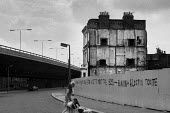 1975: Demolition of houses on Acklam Road, Notting Hill, West London. Graffiti: HOW MANY BRIDGES DO WE NEED TO CROSS BEFORE WE GET TO MEET THE BOSS - BURNIN' and A LOOTIN' TONITE after Bob Marley and... - Philip Wolmuth - 14-03-1975