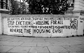 London 1975 Graffiti protesting at cuts in housing spending and eviction of squatters by the GLC from houses in Elgin Avenue. Stop Evictions, Housing for All, Reverse the Housing Cuts - Philip Wolmuth - 1970s,1975,activist,activists,against,anti,campaign,campaigner,campaigners,campaigning,CAMPAIGNS,cities,city,council,Council Housing,Council Housing,cuts,DEMONSTRATING,Demonstration,DEMONSTRATIONS,emp
