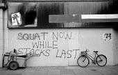 1976: squatting graffiti on Westbourne Grove. Notting Hill, West London. Squat whilst stocks last - Philip Wolmuth - 01-03-1976