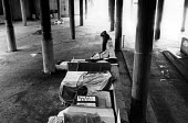 Shelters built by the homeless in Cardboard City, Waterloo, central London. - Philip Wolmuth - ,1980s,1989,asleep,cities,city,deprivation,EQUALITY,excluded,exclusion,EXHAUSTION,HARDSHIP,homeless,homelessness,impoverished,impoverishment,INEQUALITY,male,man,Marginalised,men,people,person,persons,